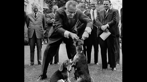 Lyndon Johnson Lifts Dog by Ears