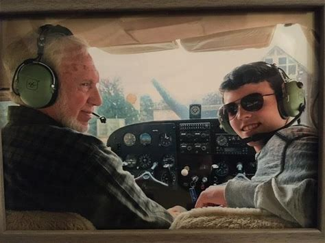 """Picture of the Day: Almost 80 and almost 18 Tom and Evan Collier submitted the following photo and note: """"Grandfather with 22,000 hours and grandson's first lesson with a big grin and enthusiasm. Loves flying in the mountains in the Cessna Skyhawk."""" Would you like to have your photo featured as Picture of the Day?"""