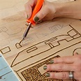 Use a woodburning tool to burn the design into the wood with the ...