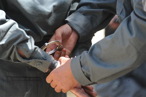 File:An Afghan National Police (ANP) recruit handcuffs ...