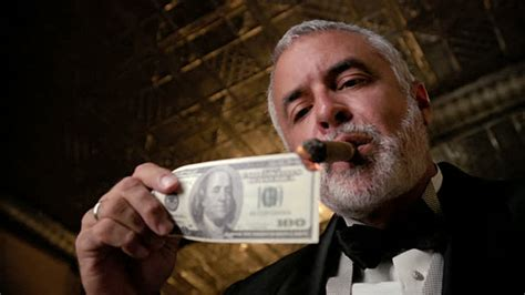 Lowangle Shot Of Man In Tuxedo Lighting Cigar With Us100 ...