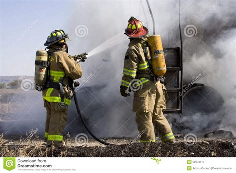 Firefighters in action stock image. Image of firefighters ...