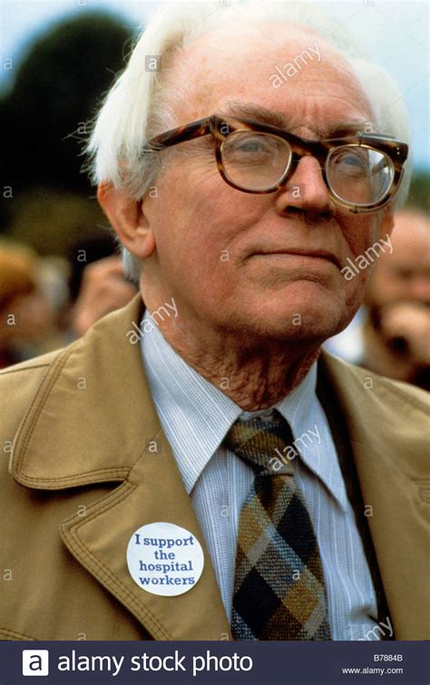 Michael Foot, leader of the Labour Party, wears a badge in ...