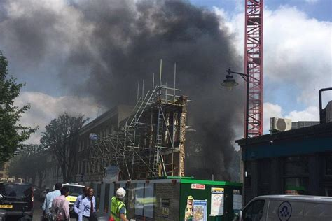 King's Cross fire: Smoke billows into sky as huge fire ...