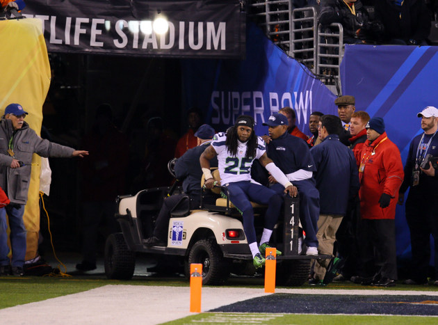 Seahawks cornerback Richard Sherman carted off the field because an ankle injury