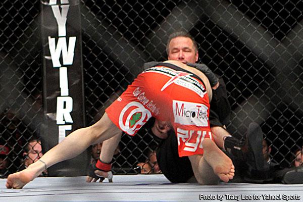 Photo: Jon Fitch wrestles referee after UFC 141 knockout