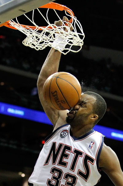 Photo: Shelden Williams dunks the ball into his face, nobody is surprised